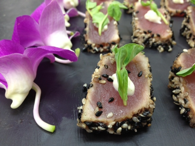 Seared sesame Ahi Tuna bites with wasabi aioli & pea shoots